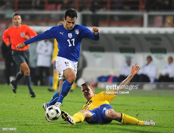 Giuseppe Rossi of Italy battles for the ball against Pontus Wernbloom of Sweden during the International Friendly Match between Italy and Sweden at...
