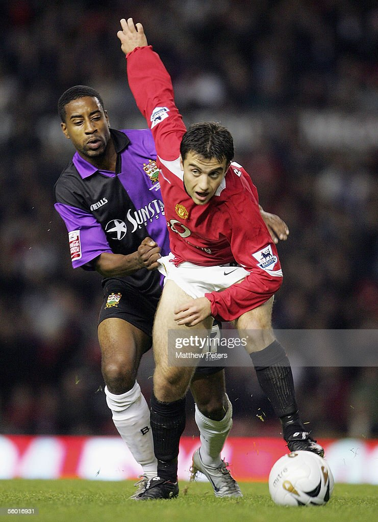 Giuseppe Rossi of Manchester United clashes with Dwane Lee of Barnet during the Carling Cup third round match between Manchester United and Barnet at...