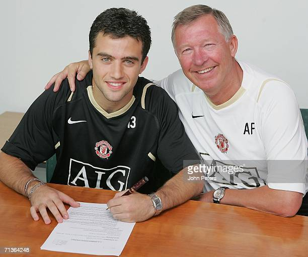 Giuseppe Rossi of Manchester United poses with Sir Alex Ferguson after signing a new contract at Carrington Training Ground on July 4 2006 in...