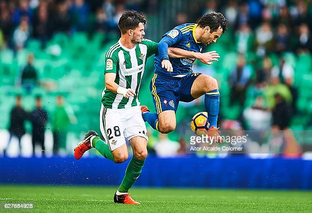 Giuseppe Rossi of RC Celta de Vigo competes for the ball with Jose Carlos Rodriguez of Real Betis Balompie during La Liga match between Real Betis...