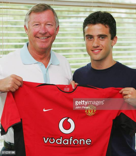 Giuseppe Rossi poses with Sir Alex Ferguson of Manchester United after signing for Manchester United on July 6 2004 at Carrington Training Ground in...