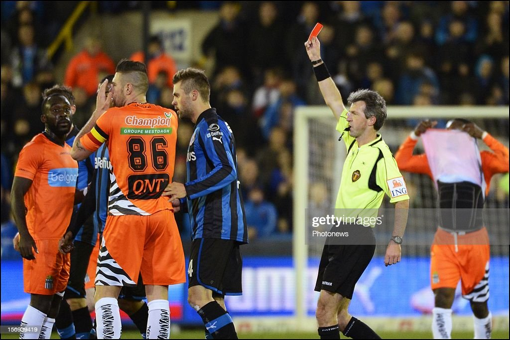 Giuseppe Rossini of Charleroi receiving his red card pictured during the Jupiler League match between Club Brugge K.V and R.C.S.Charleroi November 25, 2012 in Brugge, Belgium.