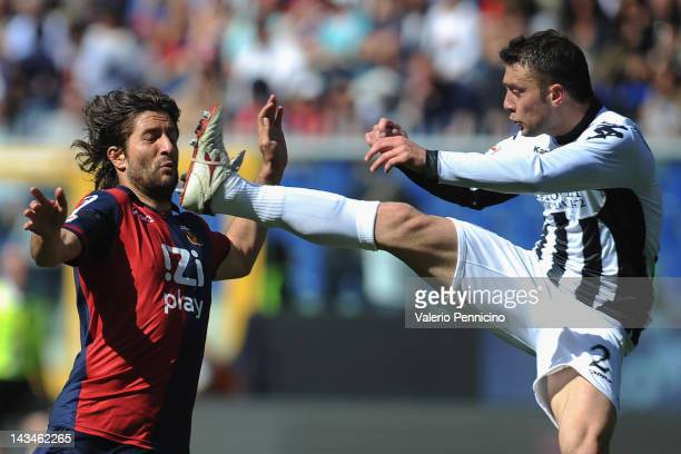 Giuseppe Sculli of Genoa CFC clashes with Roberto Vitiello of AC Siena during the Serie A match between Genoa CFC and AC Siena at Stadio Luigi...
