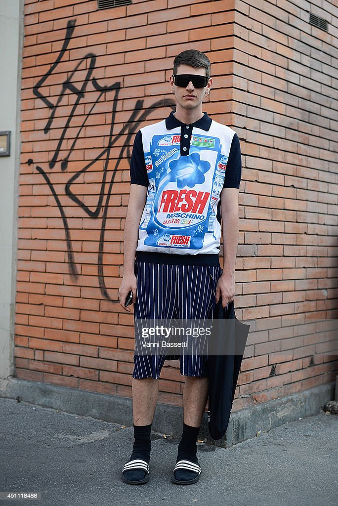 Giuseppe Sileo is seen wearing a Moschino t-shirt, Adidas slippers and vintage sunglasses after Fendi show on June 23, 2014 in Milan, Italy.