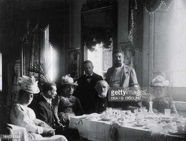 Giuseppe Verdi surrounded by his friends at his home in Montecatini Italy From left Giuseppina Pasqua Senator Grocco Teresa Stolz the maestro Mugnone...