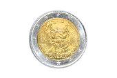 Italy coin of two euro closeup with head side of the famous Italian composer Giuseppe Verdi, artist of operas like La Traviata, Rigoletto, Va Pensiero and Aida. Isolated on white studio background.