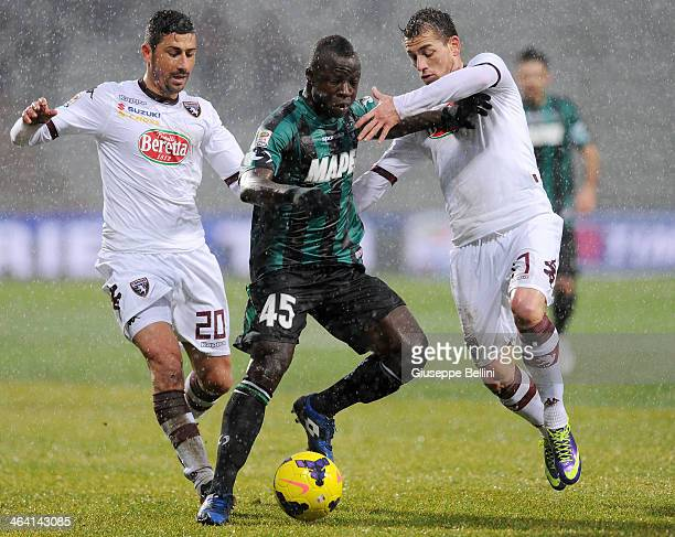 Giuseppe Vives of Torino and Yussif Raman Chibsa of Sassuolo and Salvatore Masiello of Torino in action during the Serie A match between US Sassuolo...