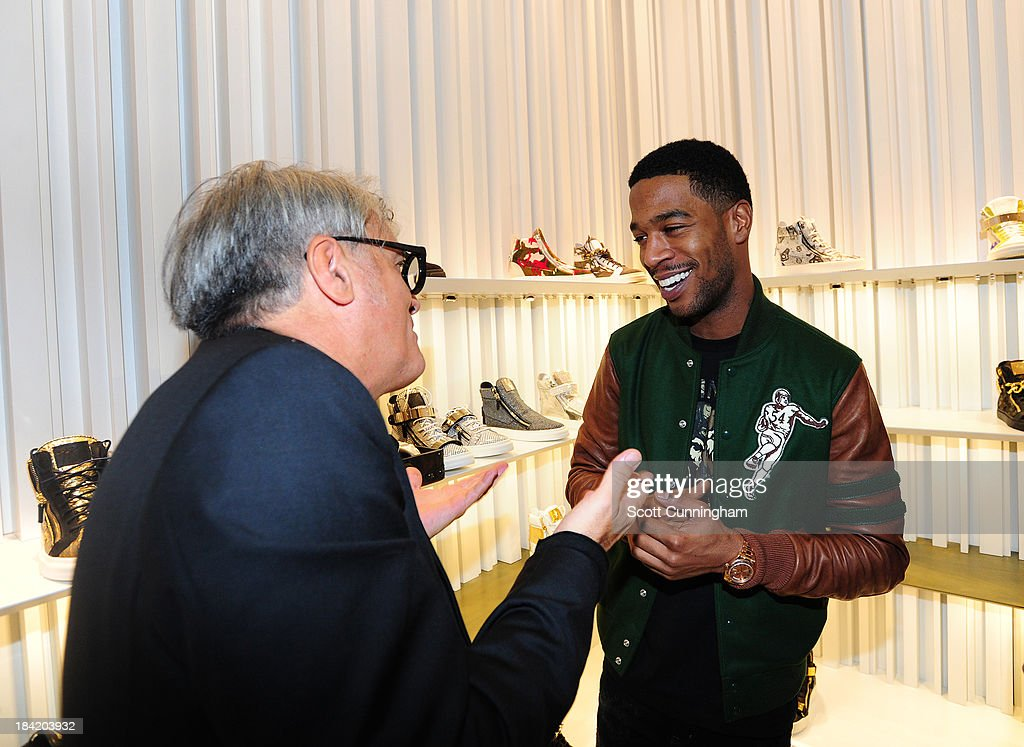 Giuseppe Zanotti and <a gi-track='captionPersonalityLinkClicked' href=/galleries/search?phrase=Kid+Cudi&family=editorial&specificpeople=5633679 ng-click='$event.stopPropagation()'>Kid Cudi</a> attend the Opening Party for the Giuseppe Zanotti Store at Phipps Plaza on October 11, 2013 in Atlanta, Georgia.