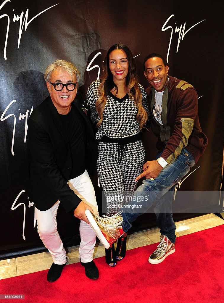 Giuseppe Zanotti (L) and Recording artist <a gi-track='captionPersonalityLinkClicked' href=/galleries/search?phrase=Ludacris&family=editorial&specificpeople=203034 ng-click='$event.stopPropagation()'>Ludacris</a> with guest attend the Opening Party for the Giuseppe Zanotti Store at Phipps Plaza on October 11, 2013 in Atlanta, Georgia.