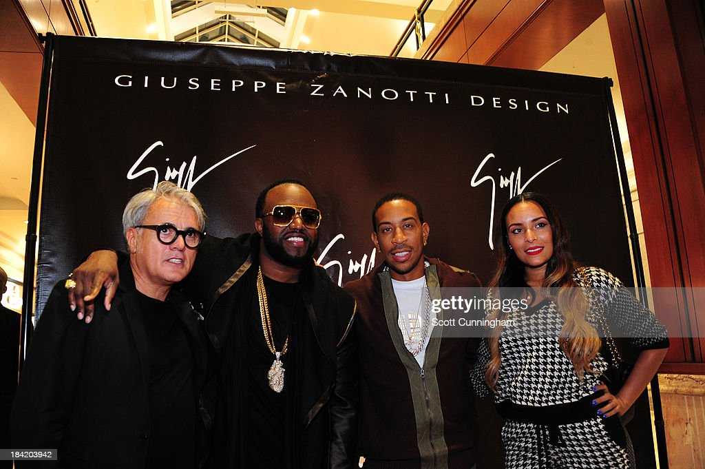 Giuseppe Zanotti, <a gi-track='captionPersonalityLinkClicked' href=/galleries/search?phrase=Rico+Love&family=editorial&specificpeople=691968 ng-click='$event.stopPropagation()'>Rico Love</a>, Recording artist <a gi-track='captionPersonalityLinkClicked' href=/galleries/search?phrase=Ludacris&family=editorial&specificpeople=203034 ng-click='$event.stopPropagation()'>Ludacris</a>, and a guest attend the Opening Party for the Giuseppe Zanotti Store at Phipps Plaza on October 11, 2013 in Atlanta, Georgia.