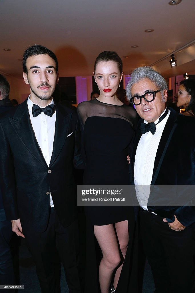 <a gi-track='captionPersonalityLinkClicked' href=/galleries/search?phrase=Giuseppe+Zanotti+-+Fashion+Designer&family=editorial&specificpeople=9764065 ng-click='$event.stopPropagation()'>Giuseppe Zanotti</a> (R) with his son and his daughter attend the Annual Charity Dinner hosted by the AEM Association Children of the World for Rwanda on December 17, 2013. Held at Espace Pierre Cardin in Paris, France.