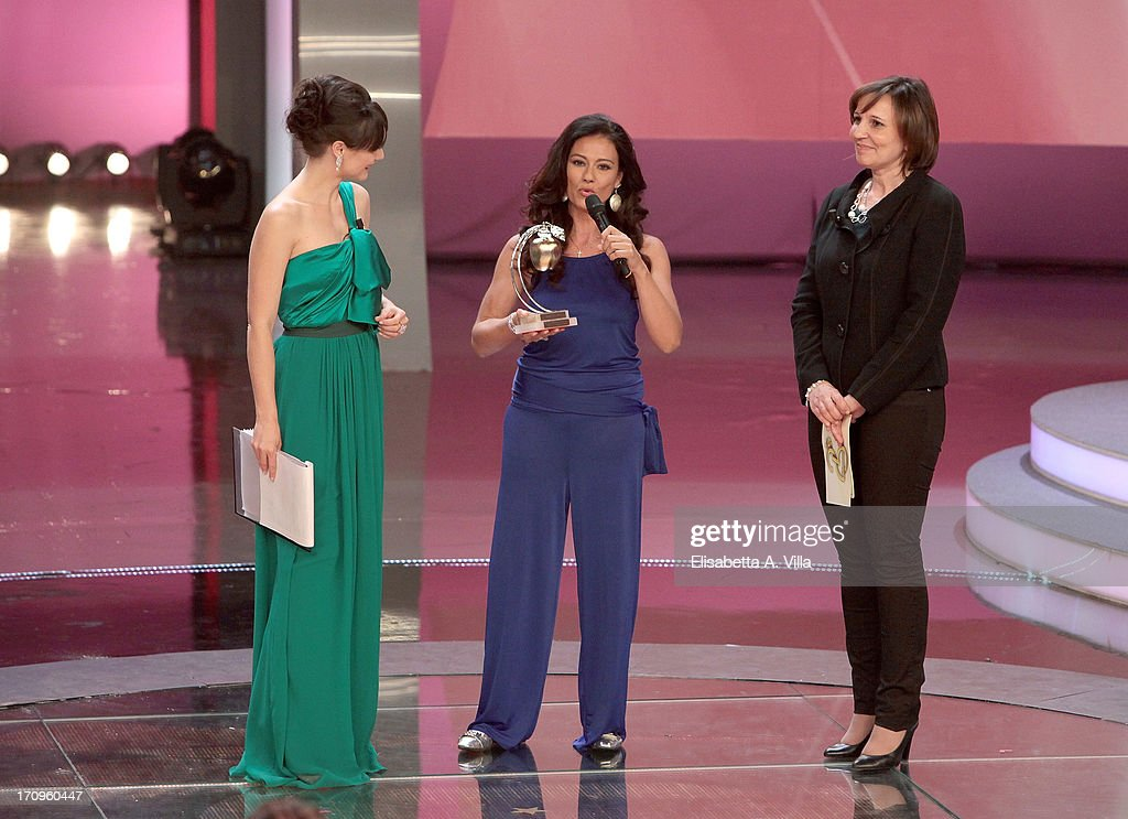 Giuseppina Versace (C) receives Bellisario award from Sabrina De Camillis (R) during the Premio Bellisario 2013 at Dear RAI studios on June 20, 2013 in Rome, Italy.