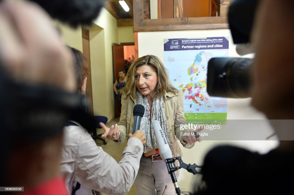 Giusi Nocolini, Mayor of Lampedusa speaks with journalists on October 8, 2013 in Lampedusa, Italy. The search for bodies continues off the coast of Southern Italy as the death toll of African migrants who drowned as they tried to reach the island of Lampedusa is expected to reach over 300 people. The tragedy has bought fresh questions over the thousands of asylum seekers that arrive into Europe by boat each year.