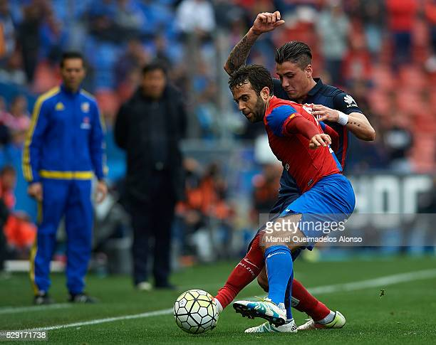Giusseppe Rossi of Levante competes for the ball with Jose Maria Gimenez during La Liga match between Levante UD and Atletico de Madrid at Ciutat de...