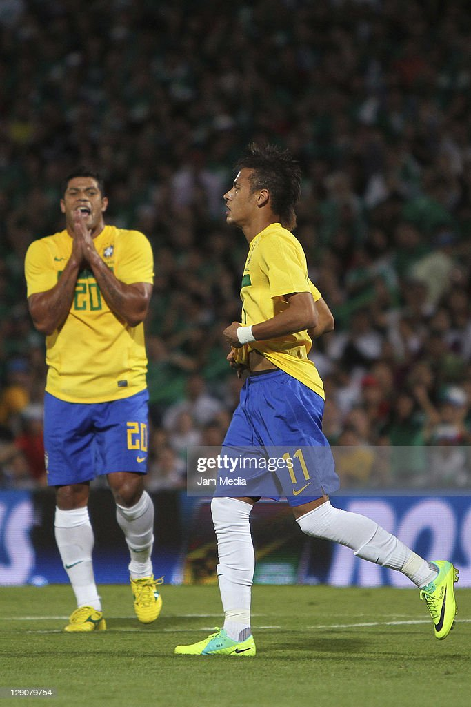 Givanildo Vieira de Souza (L) and Neimar da Silva (R) of Brasil reacts during a friendly match between Mexico National Team and Brasil National Team at the Georgia Dome on October 11, 2011 in Torreon, Mexico.