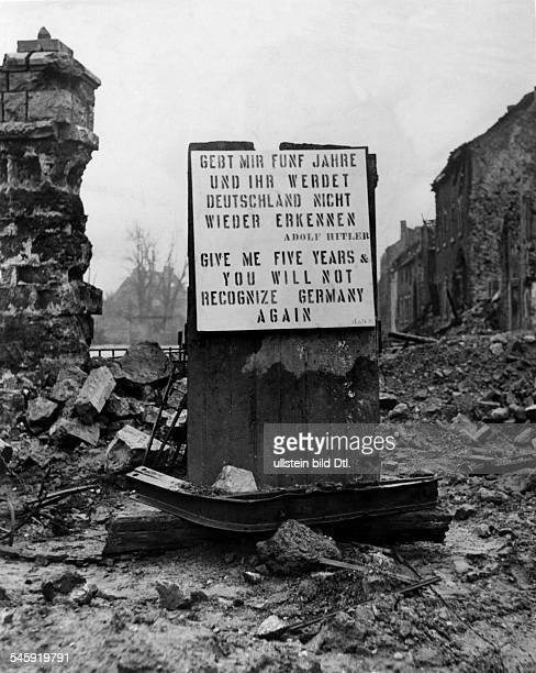 AACHEN 1945 'Give me five years and you will not recognize Germany again' Quote by Adolf Hitler on a sign written in both English and German posted...