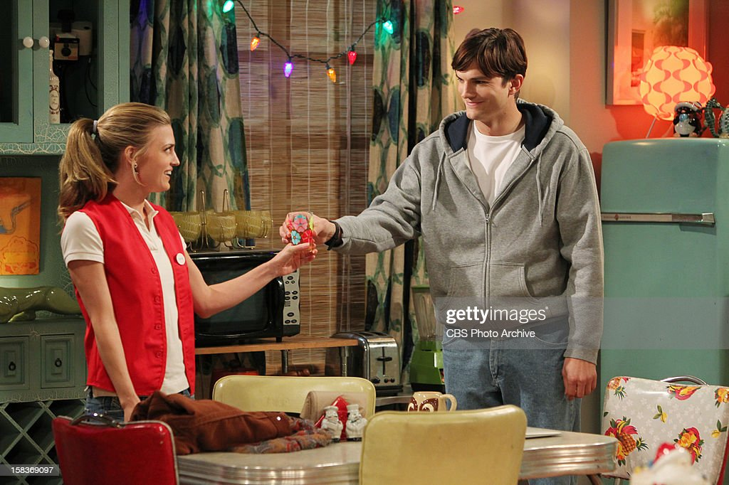 'Give Santa a Tail-Hole' -- Walden juggles having two identities - rich man and poor man, and Alan finds himself alone at Christmas, on TWO AND A HALF MEN, Thursday, date (8:31 - 9:01 PM, ET/PT) on the CBS Television Network. Pictured L-R: Brooke D'Orsay as Kate and Ashton Kutcher as Walden