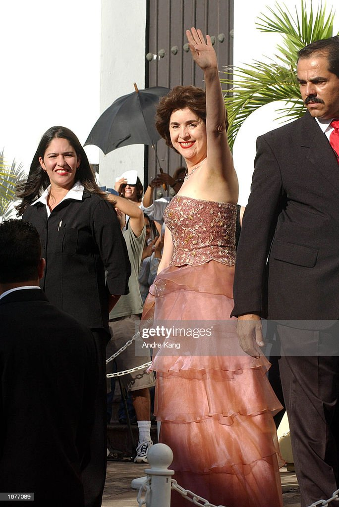 Givernor Sila Maria Calderon waves to fans as she arrives at the Old San Juan Cathedral for singer Marc Anthony and wife Dayanara Torres' Catholic wedding December 7, 2002 in San Juan, Puerto Rico.