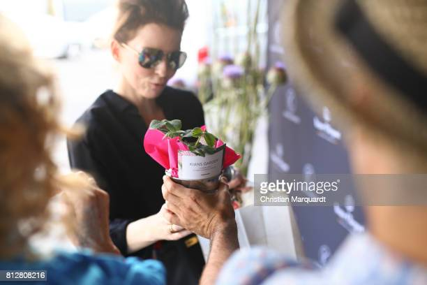 Giveways distributed during the 'Kians Garden Flower Shop' Opening Event at Kantstrasse on July 11 2017 in Berlin Germany