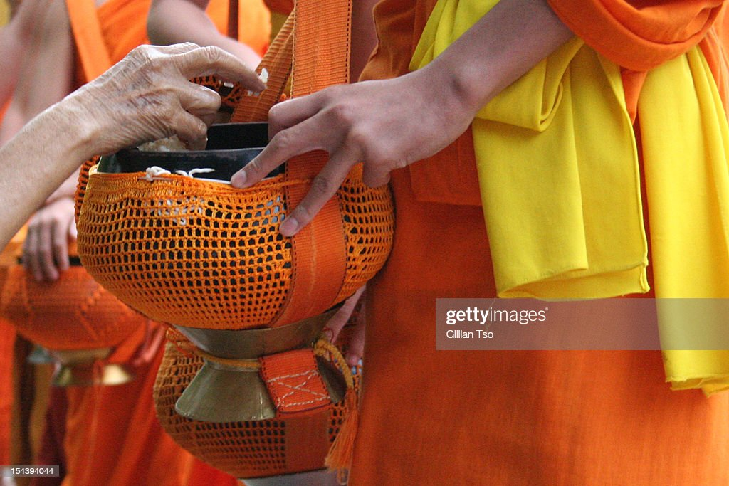 Giving and Receiving Alms : Stock Photo