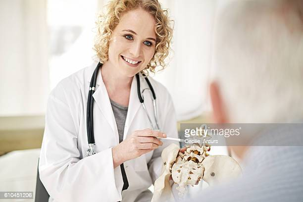 Giving her patient a hands on diagnosis