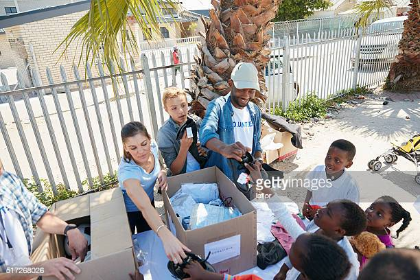Giving out school uniforms