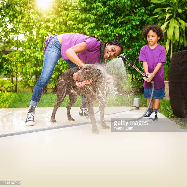 Giving the dog a bath and having fun