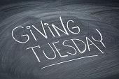 Giving Tuesday  - white chalk handwriting on a  blackboard
