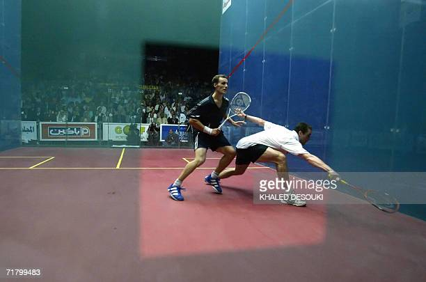 Australian player David Palmer returns the ball to French squash player Gregory Gaultier during the final of the AlAhram World Open Squash...