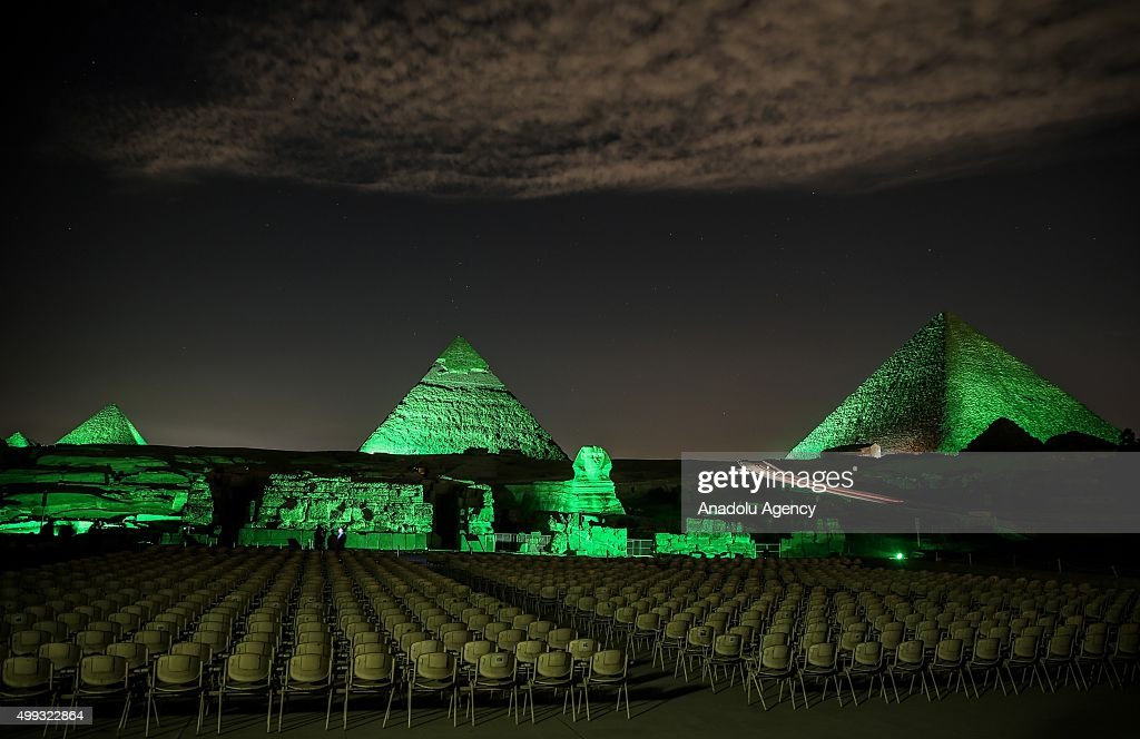 Giza Pyramids illuminated with green light on November 30, 2015, in the framework of the United Nations Climate Summit in Paris, in Giza, Egypt.
