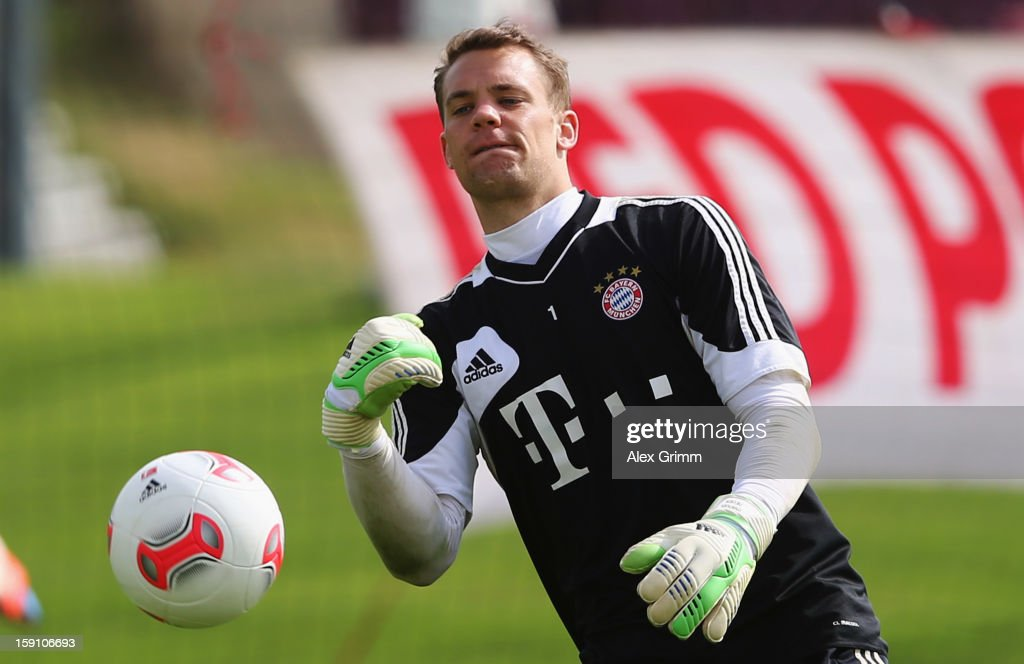 gk <a gi-track='captionPersonalityLinkClicked' href=/galleries/search?phrase=Manuel+Neuer&family=editorial&specificpeople=764621 ng-click='$event.stopPropagation()'>Manuel Neuer</a> holds thGoalkeepere ball during a Bayern Muenchen training session at the ASPIRE Academy for Sports Excellence on January 8, 2013 in Doha, Qatar.