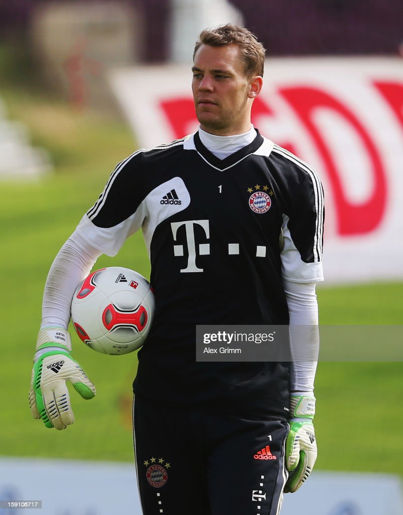 gk Manuel Neuer holds thGoalkeepere ball during a Bayern Muenchen training session at the ASPIRE Academy for Sports Excellence on January 8, 2013 in Doha, Qatar.