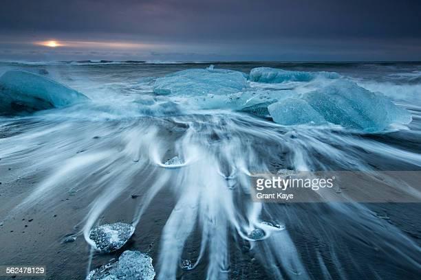 Glacial ice from Breiamerkurjkull sits on the beach of the coast at Breiamerkursandur, Iceland, also known as the Jokulsarlon.