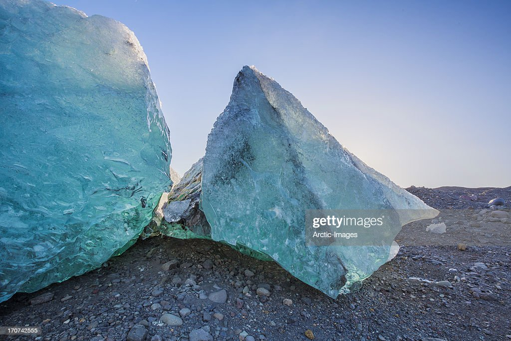 Glacial Ice on black sands : Stock Photo