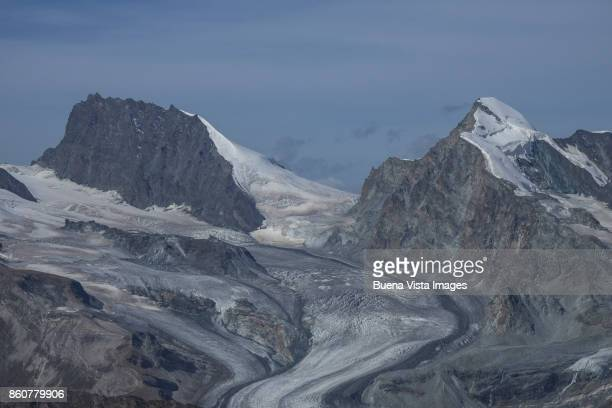 Glacier among mountains in the Alps