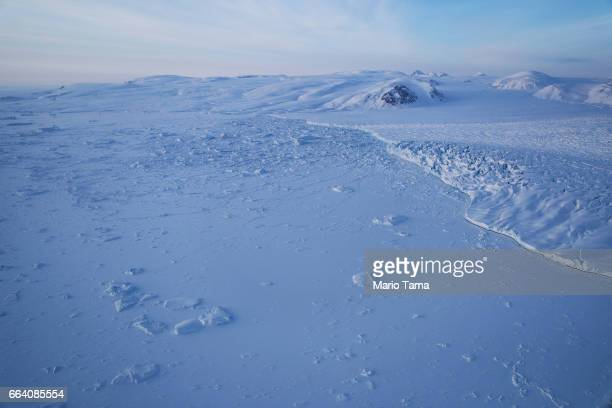 A glacier and sea ice are seen from NASA's Operation IceBridge research aircraft on March 30 2017 above Ellesmere Island Canada The ice fields of...