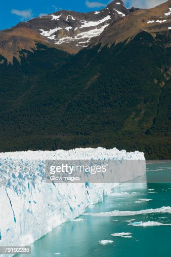 Glacier in a lake with a mountain in the background, Moreno Glacier, Argentine Glaciers National Park, Lake Argentino, El Calafate, Patagonia, Argentina : Stock Photo