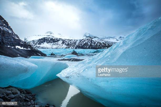 Glacier in Iceland - Blue icebergs floating in the lagoon