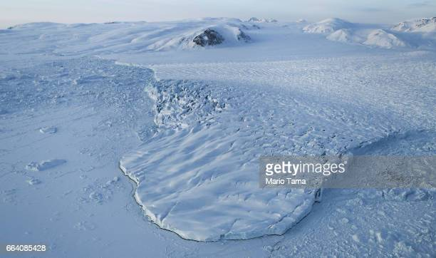 A glacier is seen from NASA's Operation IceBridge research aircraft on March 30 2017 above Ellesmere Island Canada The ice fields of Ellesmere Island...