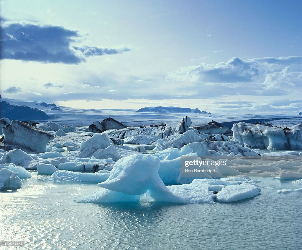 Glaciers floating on arctic water : Stock Photo