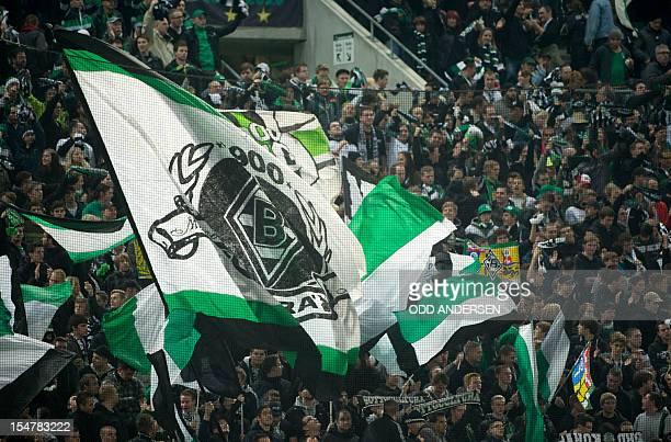Gladbach fans wave flags during the UEFA Europa League Group C football match VfL Borussia Moenchengladbach vs Olympique de Marseille in...