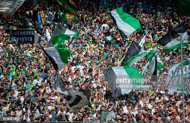 Gladbach's Fans support their team during the German first division Bundesliga football match between Borussia Moenchengladbach and Bayer 04...