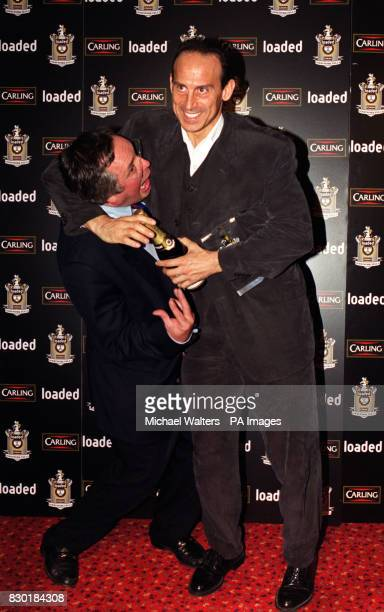 Gladiator star Wolf gets to grips with television's Countdown presenter Richard Whiteley at the 'Loaded Carling Good Work Fella Awards' presentation...