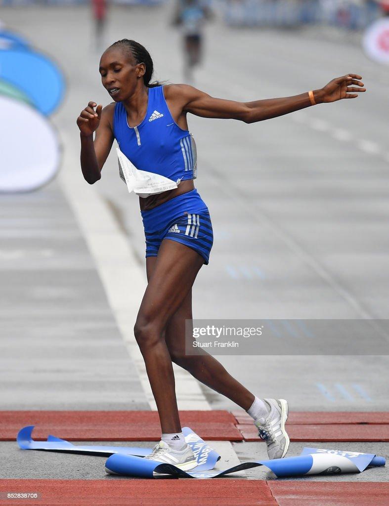 Gladys Cherono of Kenia crosses the finishing line to win the Ladies Berlin marathon on September 24, 2017 in Berlin, Germany.