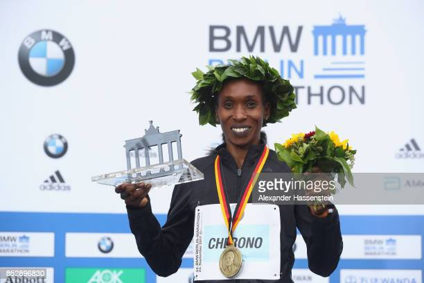 Gladys Cherono of Kenya celebrates at the victory ceremony winning the BMW Berlin Marathon 2017 on September 24 2017 in Berlin Germany