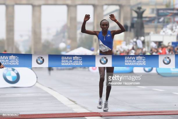 Gladys Cherono of Kenya celebrates winning the BMW Berlin Marathon 2017 on September 24 2017 in Berlin Germany
