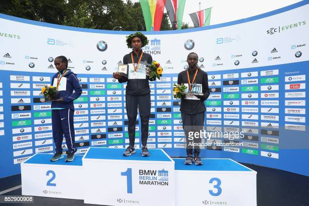 Gladys Cherono of Kenya celebrates winning the BMW Berlin Marathon 2017 with Ruti Aga of Ethiopia who wons the 2nd place and Valary Aiyabei of Kenya...