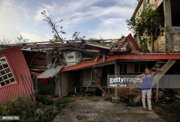 Gladys Francisco stands in front of her destroyed home after US soldiers unloaded food and water provided by FEMA to residents in the neighborhood...