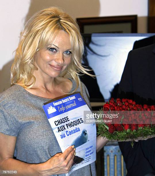 Glam celeb and 'Baywatch' star Pamela Anderson poses as she came to the Brigitte Bardot foundation for animal rights to support its fight against...