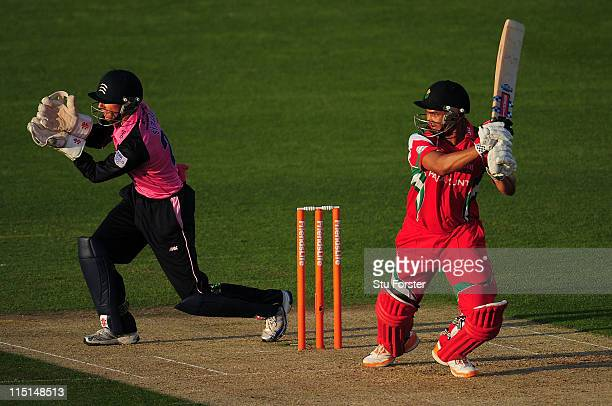 Glamorgan batsman Alviro Petersen hits out as Middlesex keeper Jon Simpson looks on during the Friends Life T20 match between Glamorgan and Middlesex...